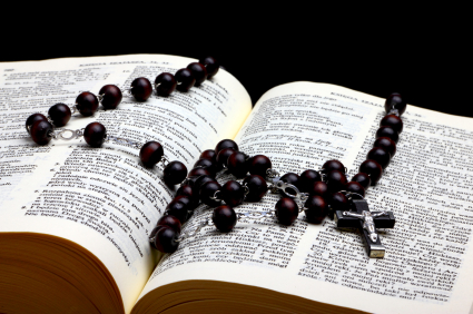 Christian Holy Bible with Cross on rosary